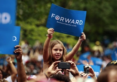 A girl holds up a sign as U.S. President Barack Obama speaks at a campaign rally at Eden Park in Cincinnati