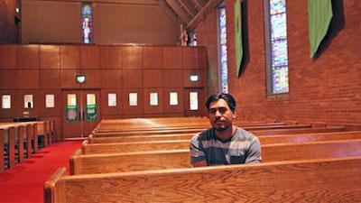 man takes refuge in church